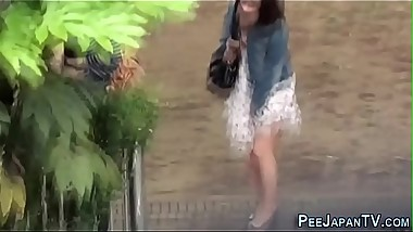 Watched asian teen pees in park