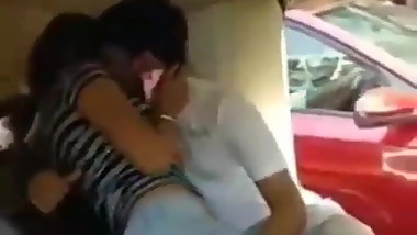 Cute couple doing romance in a taxi