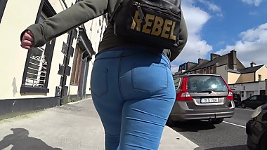 Candid big arse redhead in tight jeans