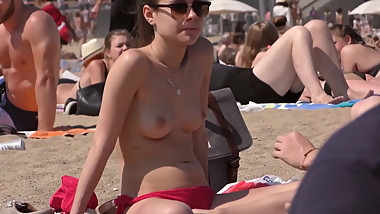 Teen Topless On The Beach