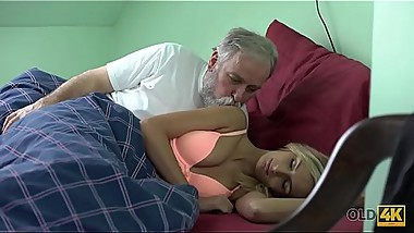 OLD4K. Blonde and old husband interrupted tea to make love on sofa