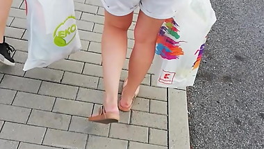 Candid Teen Walking in Blue Shorts on the Shoping Center