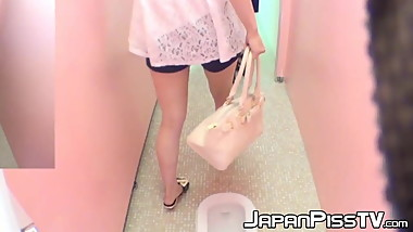 Kinky Asian cuties have fun peeing in public toilet